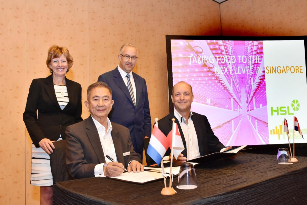 Contract signing by Mr Lim Choo Leng (chairman HSL) and Mr Wouter Vos (chairman Urban Farming Partners), under the watchful eye of Ms Margriet Vonno, Netherlands ambassador in Singapore, and Mr Ahmed Aboutaleb, mayor of Rotterdam.